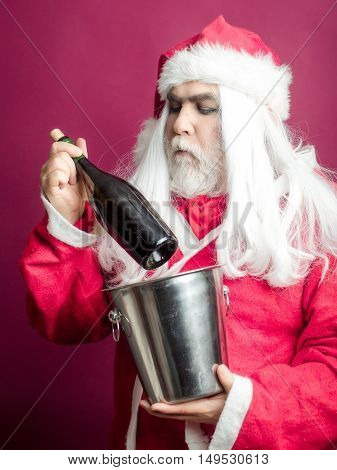 Serious Christmas Man With Bottle In Pail