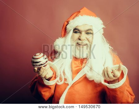 Smiling Christmas Man With Decorative Ball