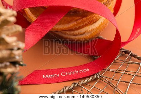 Red Christmas Ribbon Alongside Orange Slices And Wire Mesh