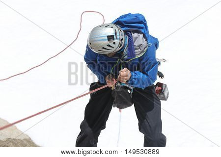 Chamonix-Mont-Blanc, France - May 20, 2016: Unknown man climbing at Aiguille du midi in the French Alps