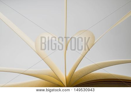 Blank Book Pages Forming A Heart On White Background
