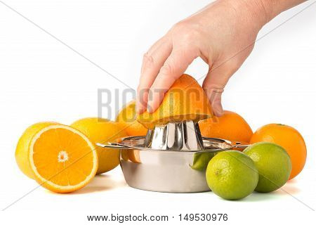 Hand Extracting An Orange In Juicer With Whole Citrus Fruits