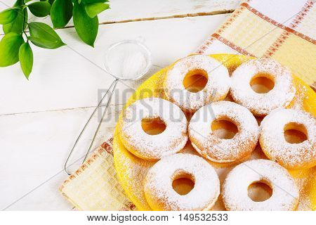 Donuts powdered by caster sugar on checkered napkin. Hanukkah sweet donuts. Sweet dessert pastry doughnuts.