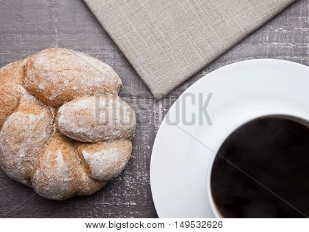 coffee cup with bread roll for breakfast morning in cafe