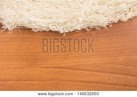 Chinese Noodles. Rice vermicelli Pasta Frame over a wooden table
