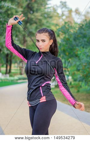 Young Fitness Girl Prepares For Training Outdoor