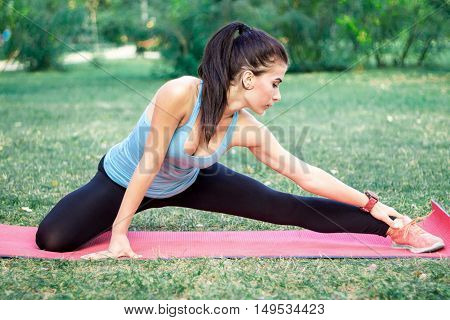 Young Fitness Girl Stretches For Training Workout