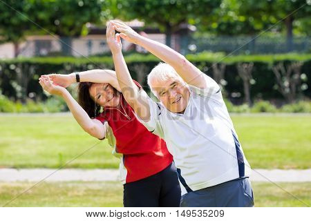 Photo Of Senior Couple Exercising Together At Park