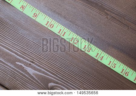 Measuring Tape On Wooden Table