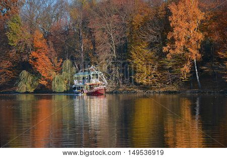 autumn walk in a beautiful park on a warm day a colorful boat