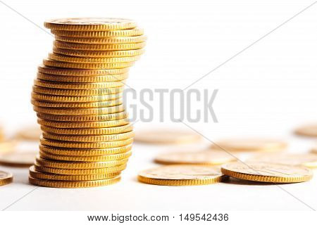 Stack of coins isolated with white background. Studio shot