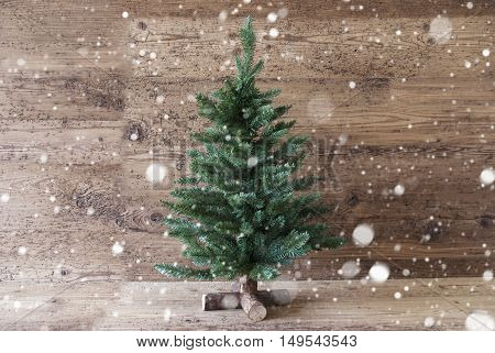 Christmas Card For Seasons Greetings And Snowflakes. Green Christmas Tree With In The Front Of Aged Wooden Background. Rustic Or Retro Style. Copy Space For Advertisement
