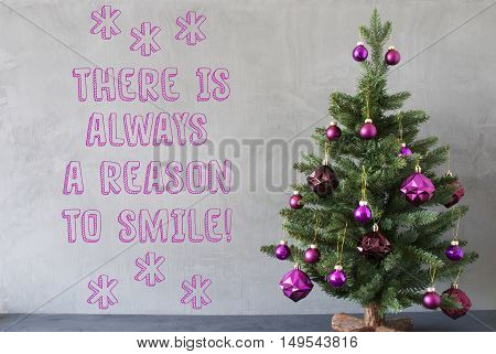 Christmas Tree With Purple Christmas Tree Balls. Card For Seasons Greetings. Gray Cement Or Concrete Wall For Urban, Modern Industrial Styl. English Quote There Is Always A Reason To Smile