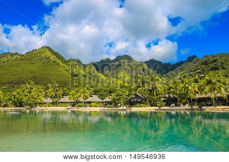Island of Moorea in the French Polynesia with her exuberant vegetation turquoise lagoon bungalow and mountains.