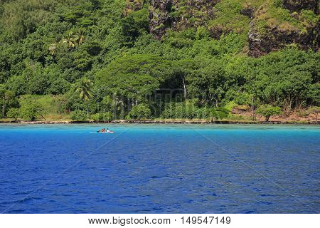 Bora Bora French Polynesia two tone sea under the clear sky. The deep blue sea with an island. A dreamed destination for honeymoon.