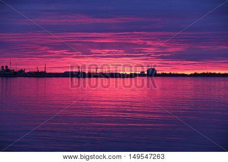 Purple and pink sunset in a river. Tallinn Estonia