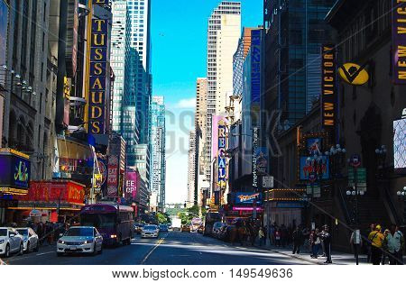 New York, United States of America - September 14, 2014. View of Broadway in New York, with residential and commercial buildings, commercial properties, shop windows, people and street traffic.