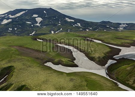 Hills with glaciers. South Kamchatka Nature Park. View from the helicopter.