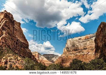 Layers upon layers of colorful red rock peaks and white clouds on the sky Zion National Park Utah
