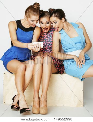 group of diverse stylish ladies in bright dresses isolated on white smiling having fun, watching selfie, lifestyle people concept close up