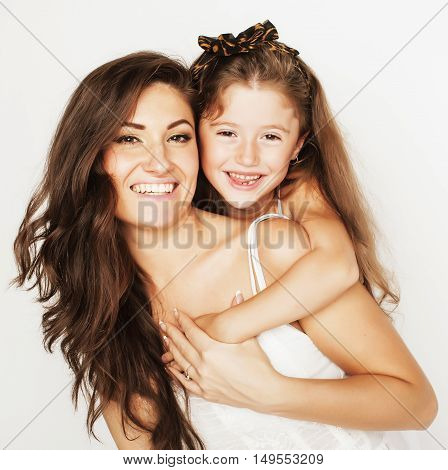 bright picture of hugging mother and daughter happy together isolated on white background, smiling stylish family. lifestyle people concept close up