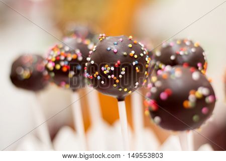 Delicious chocolate cake pops with sprinkles - sweet food