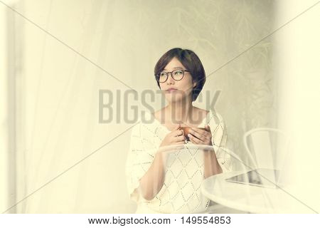 Asian Girl Drinking Tea Beverage Refreshment Relaxation Concept