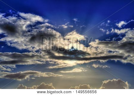 Clouds in the sky and sun rays. HDR picture.