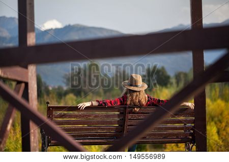 Woman In Hat On The Bench