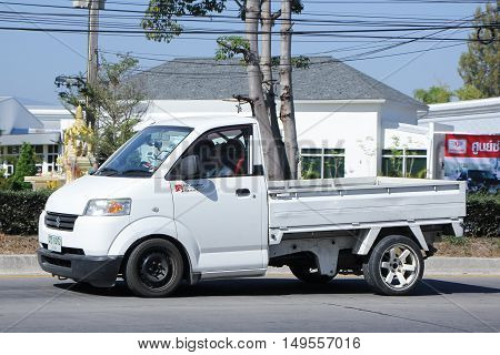 CHIANGMAI, THAILAND -DECEMBER 13 2015: Private Suzuki Carry Pick up car. Photo at road no 121 about 8 km from downtown Chiangmai, thailand.