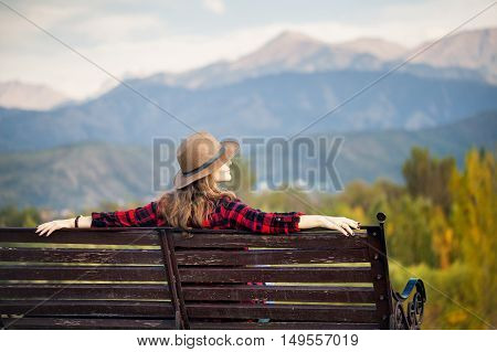 Woman On The Bench At The Park
