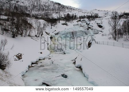 River frozen by the harsh winter of the Arctic circle . Tromso Norway