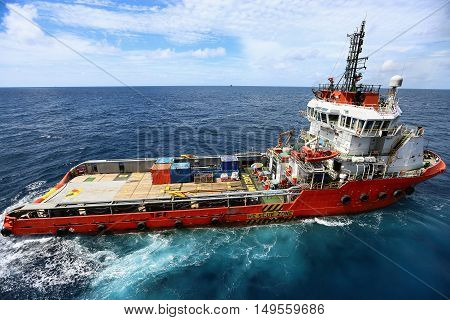 Supply boat transfer cargo to oil and gas industry and moving cargo from the boat to the platform, boat waiting transfer cargo and crews between oil and gas platform and crews boat operation in boat.