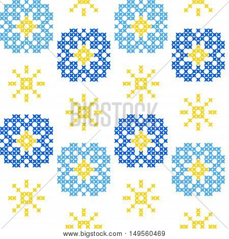 Seamless embroidered texture of abstract flat patterns, cornflowers, dandelions, cross-stitch, ornament for cloth