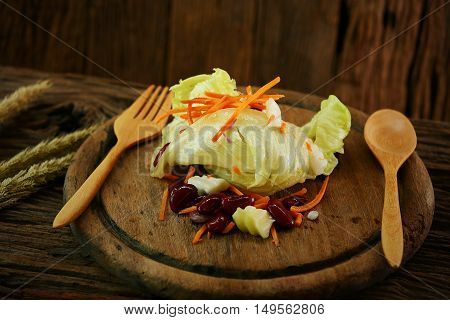 Salad on wooden plate with spoon set, Clean food in dining room for health, Diet food for some people need to burn fat, International food for health with can buy from the market and organic farm.