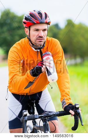 Cyclist on race bike pedaling on bike track outdoors