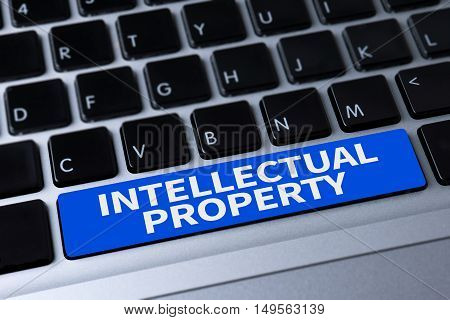 INTELLECTUAL PROPERTY a message on keyboard  business man hard work