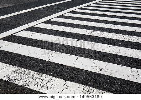 Pedestrian crossing zebra traffic walk way on asphalt road