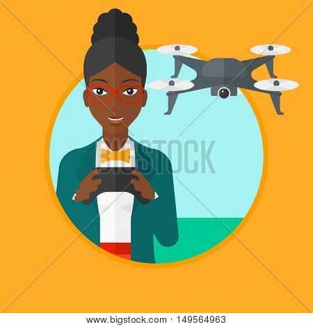 An african-american woman flying drone with remote control. Woman operating a drone with remote control. Woman controling a drone. Vector flat design illustration in the circle isolated on background.
