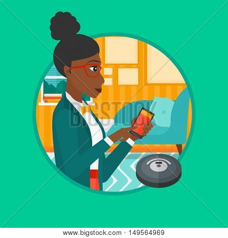 African-american woman controlling robot vacuum cleaner with smartphone. Woman holding remote control of robotic vacuum cleaner. Vector flat design illustration in the circle isolated on background.