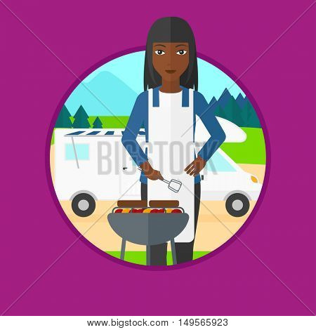 An african woman cooking meat on barbecue on the background of camper van. Woman travelling by camper van and having barbecue party.Vector flat design illustration in the circle isolated on background