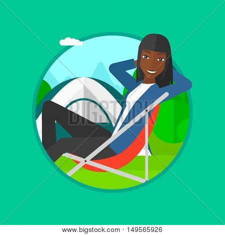 An african-american woman sitting in a folding chair in the camp. Woman relaxing and enjoying her camping holiday near the tent. Vector flat design illustration in the circle isolated on background.