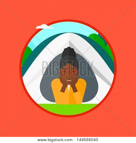 An african-american young woman crawling out from a camping tent. Woman with her hands on cheek lying in camping tent and relaxing. Vector flat design illustration in the circle isolated on background