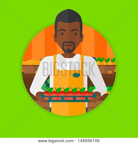 An african-american supermarket worker holding a box with apples. Supermarket worker carrying box with fruits in supermarket. Vector flat design illustration in the circle isolated on background.
