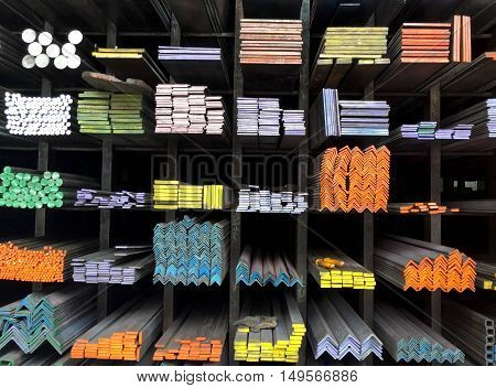 Color mark for different sizes of metal on shelf in the shop