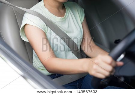 Concept safety asian woman driving a car with seat belt on for safety