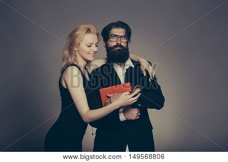 Surprised Couple Look In Smartphone