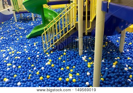 Colorful plastic balls and stair on with slider in children playground