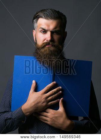 Handsome Man Holds Journal