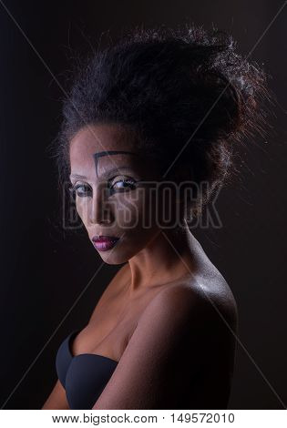 The original make-up on the face of an African American woman